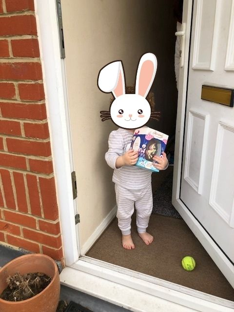 Easter fun and chocolate blog - in blog image of little girl receiving easter eggs donated by one of our supporters.